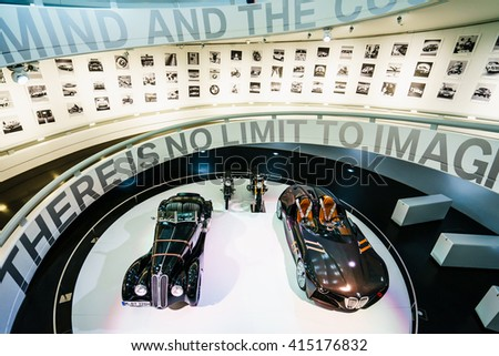MUNICH, GERMANY - MARCH 15: BMW cars and motorcycle at the BMW Museum and Welt  on March 15, 2016 in Munich, Germany. The company was founded in 1916. - stock photo