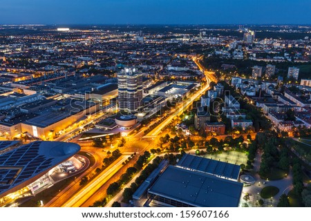 MUNICH, GERMANY - MAY 11: Aerial view of BMW Museum and Welt factory and Munich from Olympic Tower in evening on May 11, 2012 in Munich, Bavaria, Germany. BMW is famous German luxury car automaker. - stock photo
