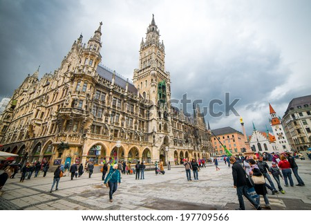MUNICH, GERMANY - MAY 13: Marienplatz in Munich on may 13, 2014. It has been the city's main square since 1158. Munich is the biggest city of Bavaria with almost 100 million visitors a year. - stock photo