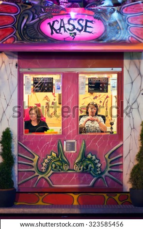 MUNICH, GERMANY - Oct. 2, 2015: Two Ladies Selling Tickets for an Event at the Annual Oktoberfest. The Festival runs from September 19th until October 4th 2015 in Munich, Germany - stock photo