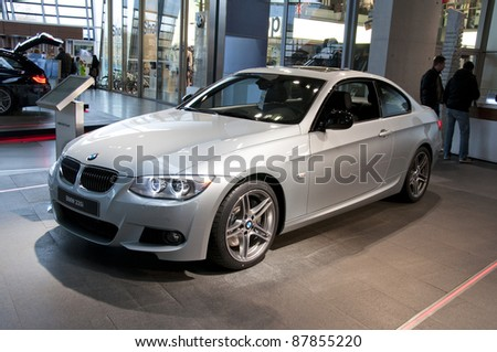MUNICH, GERMANY - OCTOBER 31: BMW Motor Show on October 31, 2011 in BMW Welt in Munich, new BMW 3 Series coupe - stock photo