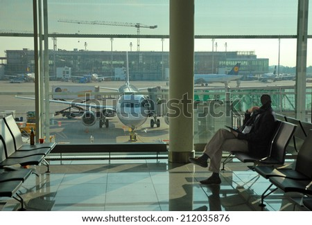 MUNICH, GERMANY-SEPTEMBER 25, 2013: business man at the airport. With 38 millions passengers per year it is one of the most important airport in Europe. - stock photo