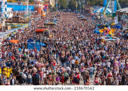 MUNICH, GERMANY - SEPTEMBER 21: Crowds of people at Oktoberfest on Munich's Theresienwiese on September 21, 2014 in Munich, Germany. - stock photo