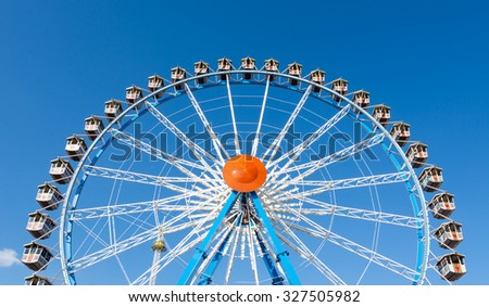 MUNICH, GERMANY - SEPTEMBER 30: Ferris wheel on Oktoberfest in Munich, Germany on September 30, 2015. The Oktoberfest is the biggest beer festival of the world with over 6 million visitors each year.  - stock photo