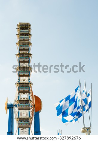 MUNICH, GERMANY - SEPTEMBER 30: ferris wheel on the Oktoberfest in Munich, Germany on September 30, 2015. The Oktoberfest is the biggest beer festival of the world with over 6 million visitors. - stock photo