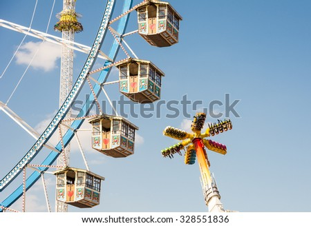 MUNICH, GERMANY - SEPTEMBER 30: Ferris wheel on the Oktoberfest in Munich, Germany on September 30, 2015. Oktoberfest is the biggest beer festival of the world with over 6 million visitors each year. - stock photo