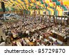 "MUNICH, GERMANY - SEPTEMBER 21: overview in a tent of Loewenbraeu brewery at world biggest beer festival ""Oktoberfest in Munich"" on September  21, 2011 in Munich, Germany - stock photo"
