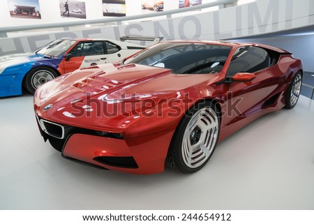 MUNICH - JANUARY 05: Modern futuristic red BMW on stand display in BMW Museum on January 05, 2015 in Munich, Bavaria, Germany. - stock photo