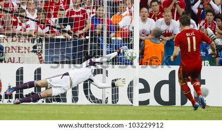 MUNICH, MAY 19 - Cech of Chelsea (L) saves the penalty of Bayern's Olic during FC Bayern Munich vs. Chelsea FC UEFA Champions League Final game at Allianz Arena on May 19, 2012 in Munich, Germany. - stock photo
