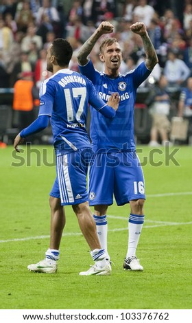 MUNICH-MAY 19 :Celebration of Chelsea's win: Meireles (R ) and Bosingwa after FC Bayern Munich vs. Chelsea FC UEFA Champions League Final game at Allianz Arena on May 19, 2012 in Munich, Germany. - stock photo