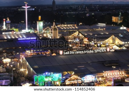 MUNICH - SEPTEMBER 28: The beer tents of the world's famous beer festival Oktoberfest attract crowds of visitors from all over the world on the night of September 28, 2012 in Munich, Germany. - stock photo