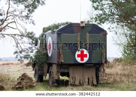 """MUNSTER / LOWER SAXONY / GERMANY - APRIL 2013: german military ambulance vehicle """" krkw """" stands on the military training ground in munster / germany at april 2013. - stock photo"""