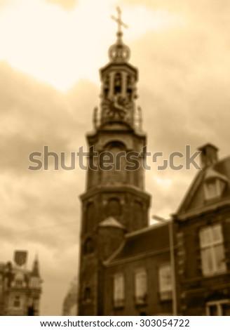 Munttoren clock tower in Amsterdam.  Blurred aged photo. Sepia. - stock photo
