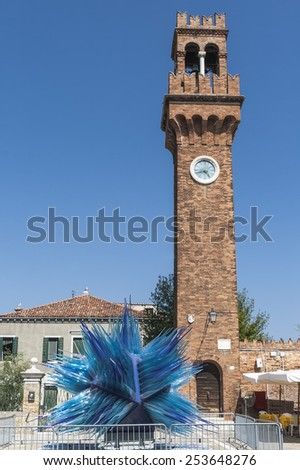 MURANO, ITALY - AUGUST 19, 2012: Modern installation of Murano glass in front of the old bell tower. Venice. Italy - stock photo