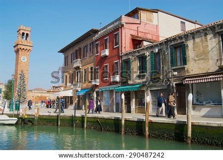 MURANO, ITALY - FEBRUARY 27, 2007: Unidentified people walk by the street in Murano, Italy. - stock photo