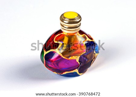 MURANO - ITALY- MARCH 13, 2016: Hand Painted Perfume Bottle. Today, the artisans of Murano still employ these centuries-old techniques from contemporary art glass to Murano glass chandeliers. - stock photo