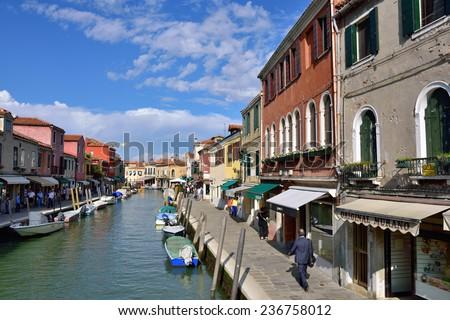 MURANO - SEP 22, 2014: Tourists from all the World are walking along water canal famous Murano island, Venice. Landmark of Veneto region, Italy - stock photo