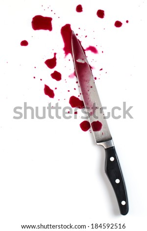 Murder. Knife in pool of blood - stock photo