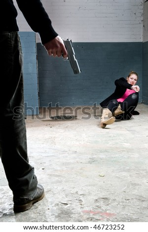 Murderer, holding a gun, face to face with a terrified woman