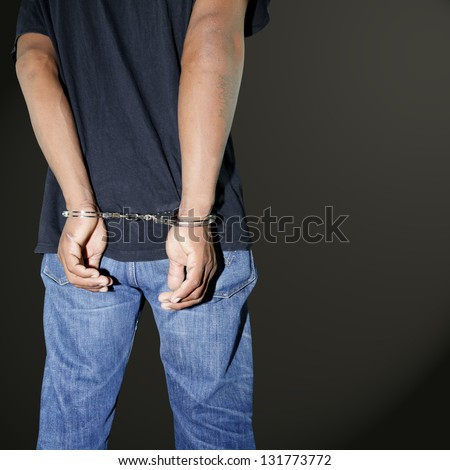Murderer locked in handcuffs - stock photo