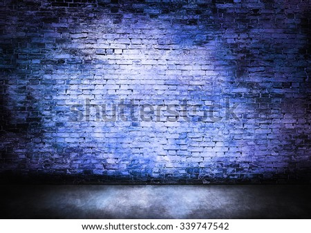 Murky brick wall in blue tones - stock photo