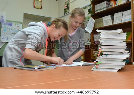Murmansk, Russia - January 20, 2014, Students prepare for the delivery of books in the school library - stock photo