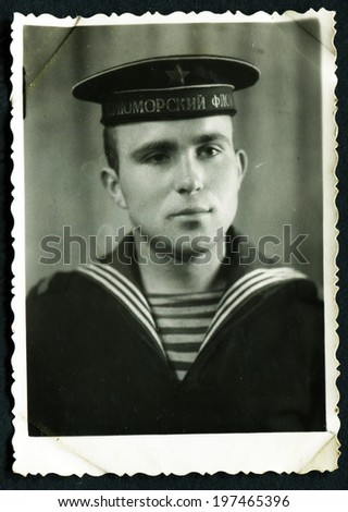 MURMANSK, USSR - CIRCA 1980: An antique photo shows portrait of a Baltic Navy submarine Midshipman in uniform. - stock photo