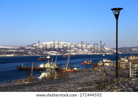 Murmansk. View of Kola bay with ships and snow hills in the bright, sunny winter day - stock photo