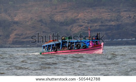 Murud-Janjira / India - March 26, 2016 - A group of people travelling from the boat in to the sea towards Murud Janjira Fort built on the ocean