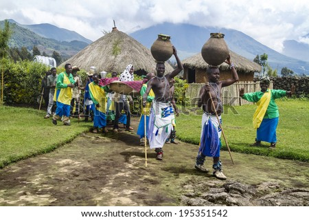 MUSANZE, RWANDA - NOVEMBER 5: Tribal ritual of the Batwa Tribe Perform Traditional Intore Dance to Celebrate the Birth of an Endangered Mountain Gorilla on November 5, 2013 in Musanze, Rwanda. - stock photo