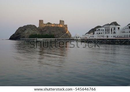 MUSCAT, OMAN -21 DEC 2016- Night view of a fort in the Sea of Oman overlooking Muscat, the capital of the Sultanate of Oman.
