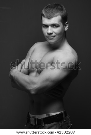 Muscle handsome young male model in studio