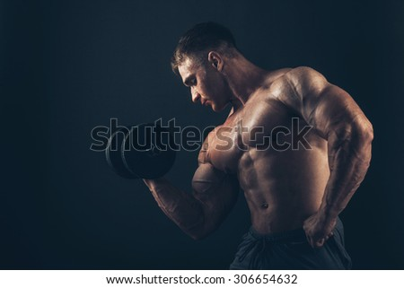 Muscle man doing bicep curls. Muscle man doing bicep curls - stock photo