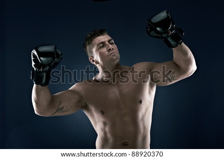 Muscle man, lots of muscles, working out, loving life. Very well built, very attractive. Boxing, Boxing Ball. - stock photo