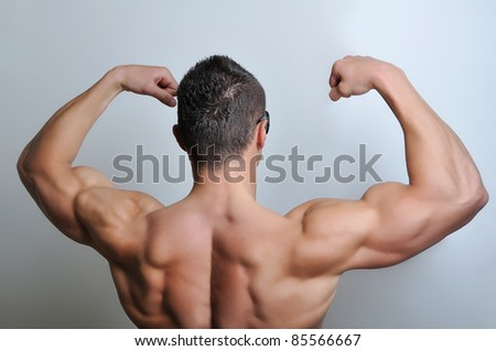 Muscle man posing - stock photo