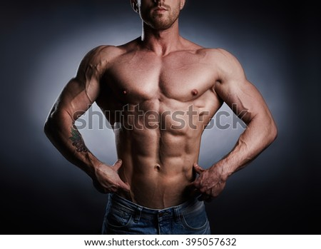 Muscle man posing in studio