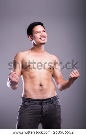 muscle man very happy successful acting - stock photo