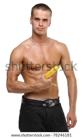 Muscle sexy wet naked young man hold the banana in hand