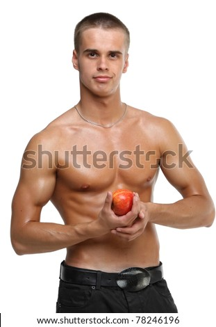 Muscle sexy wet naked young man hold the red apple in hands