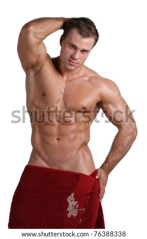 Muscle sexy wet naked young man posing wrapped in red towel