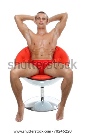 Muscle sexy wet naked young man sit in an armchair