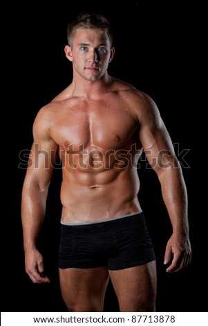 Muscle sexy young naked man posing in black boxers - stock photo