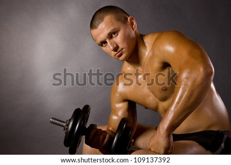 Muscled male bodybuilderweight, dumbbell, raise, swing - stock photo