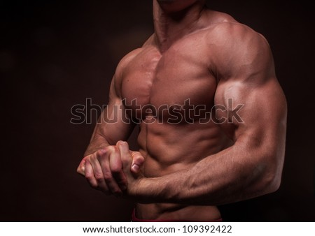 Muscled male hand with big biceps - stock photo