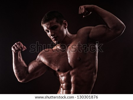 Muscled male model - stock photo