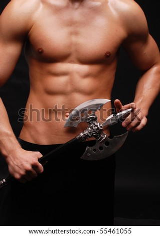 Muscled male model posing in studio - stock photo