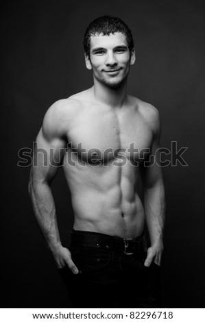 Muscled male model posing in studio - stock photo