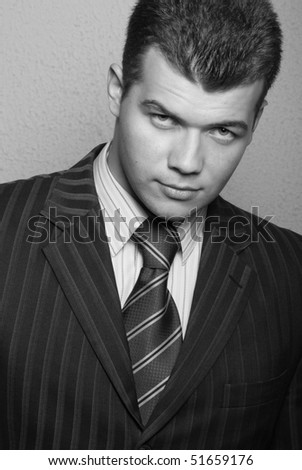 Muscled male model posing in studio in suit - stock photo
