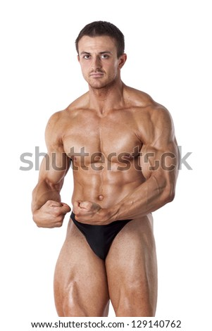 Muscled male model posing in studio on white background - stock photo