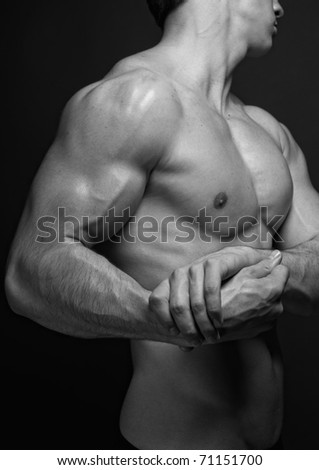 Muscled male model showing his hand - stock photo